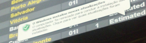 Picture shows an Operating System update pop up which is common in airports in Brazil