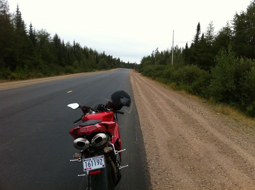 Ducati motorcycle on a long, open road