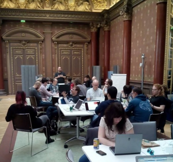 MDN weekend participants hacking and talking in the Salle des Fêtes in the Mozilla Paris office