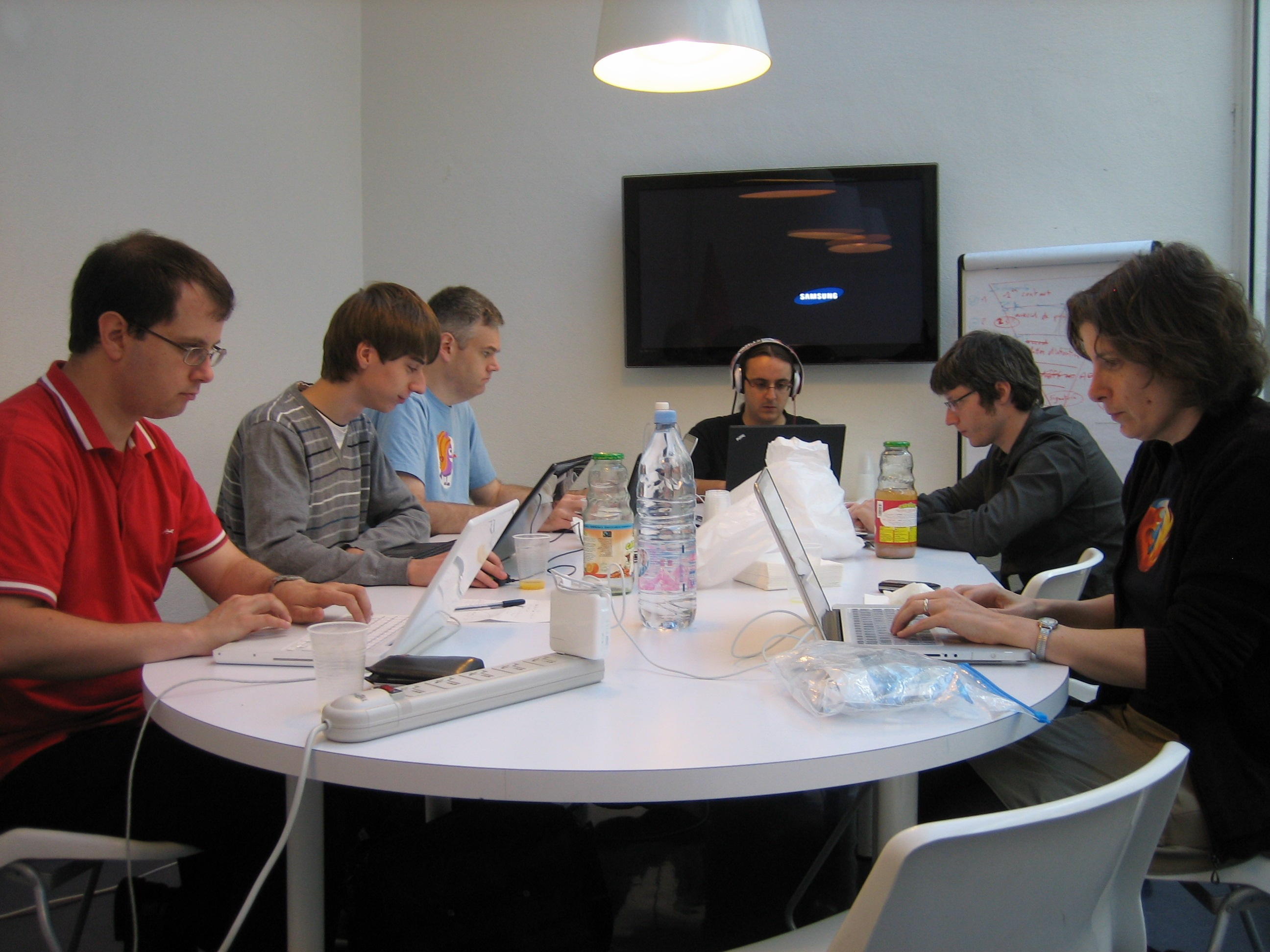 Doc contributors sitting around a table, in Paris, in October 2010