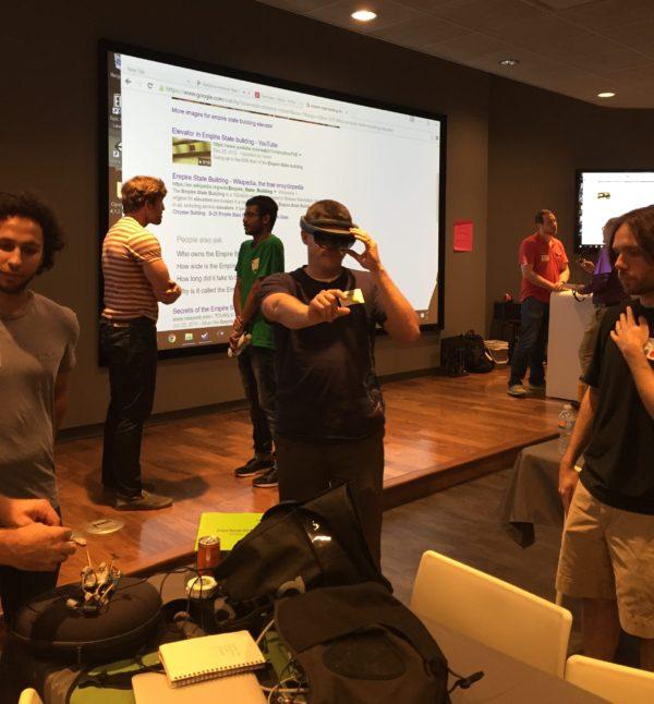 A KCVR Hackathon participant tests the Hololens during team networking.