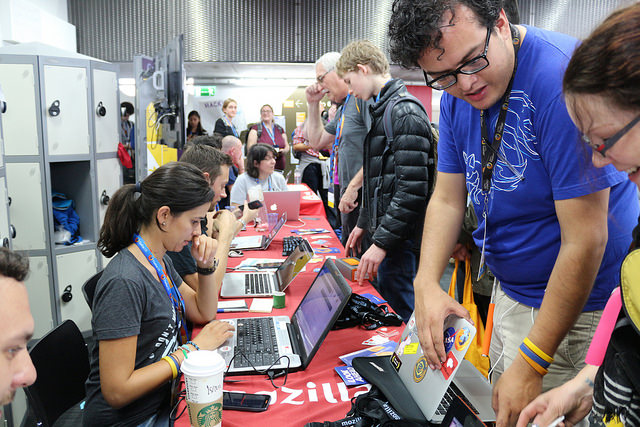Manel Rhaiem helps flash Flame phones for community members at the 2014 Mozilla Festival, London