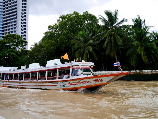 Boat public transit on the Chao Phraya River in Bangkok.