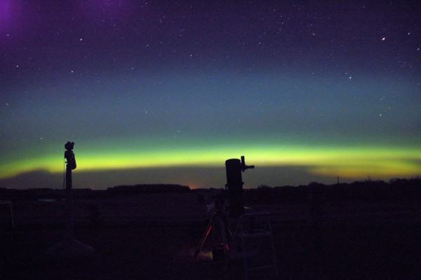 A telescope watches the aurora.