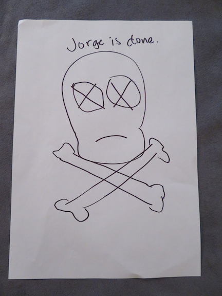 """Image: """"Jorge is done"""" text written above a skull and crossbones sketch."""