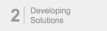 "Gray box with number 2 and the text, ""Developing Solutions."" Signals second post in three-part series."
