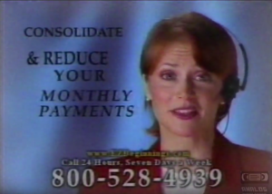 "Screenshot of a commercial from the 1980s. Includes the text, ""Consolidate and reduce your monthly payments,"" and there is a still of a woman in a red blazer and headset. A 1-800 phone number is at the bottom of the screen."