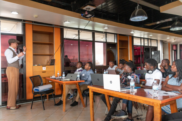 Kelly Davis, Head of Mozilla's Machine Learning Group, explaining the design and technology behind Deep Speech and Common Voice at a Hackathon in Kigali